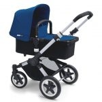 Rearward facing Bugaboo Buffalo Pram with blue sun canopy, black bassinet, underseat basket and 4 wheels