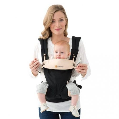 Mom carrying a baby using Ergobaby Four Position 360 Bundle of Joy Black/Camel Carrier without infant insert and baby's legs out