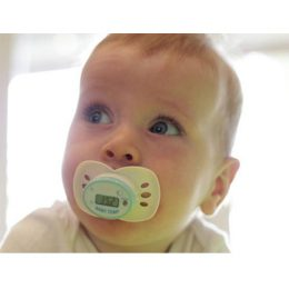 Reading temperature by placing Cherub Baby Digital Dummy Thermometer on baby's mouth while crawling