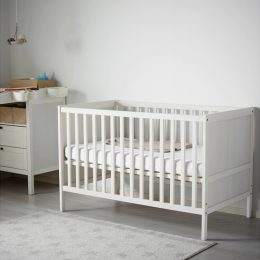 White IKEA SUNDVIK Cot with High Base Height in a Nursery Room